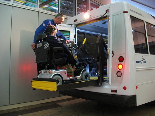 A passenger and scooter gets a lift into a HandyDart minibus.
