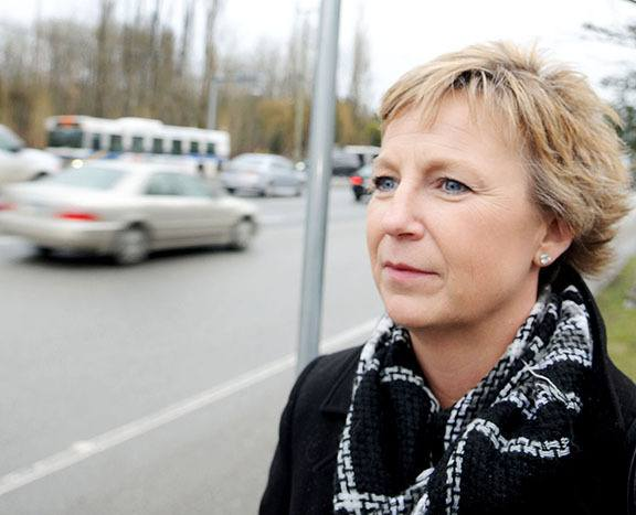 Transit user Helen Brooke waits for a bus on the west side of 200 Street. Brooke says since TransLink clawed back bus service along the 200 Street corridor, her commute time from north Langley to Murrayville has almost tripled.