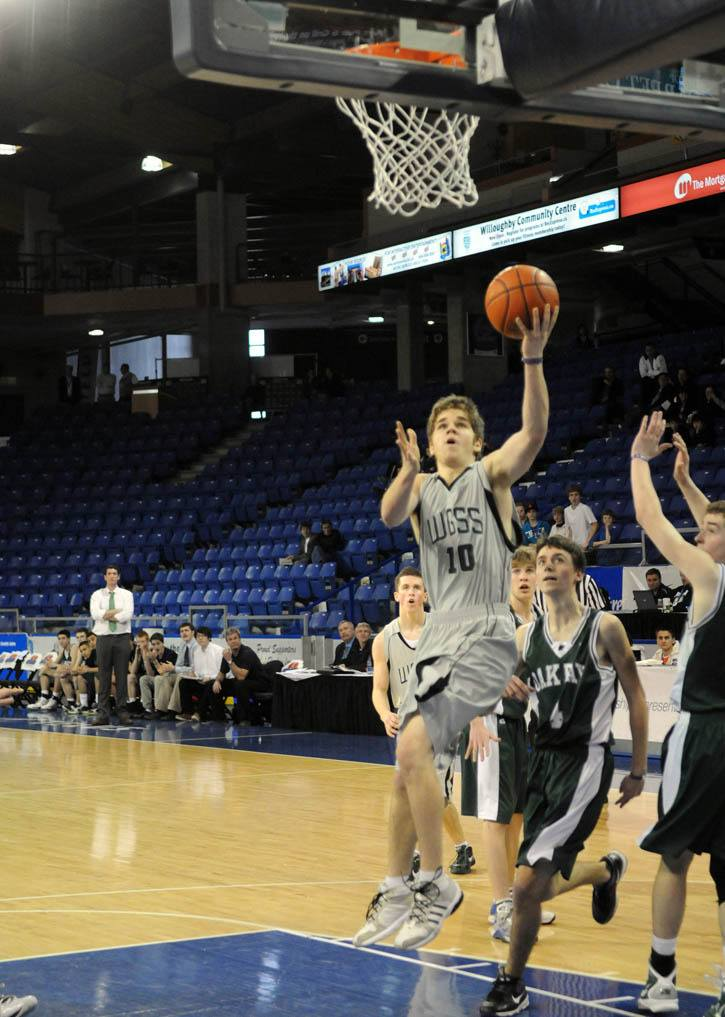 Derek Muxworthy scores two of his 25 points in the late stages of his team's 90-77 comeback victory on Friday at the Langley Events Centre.