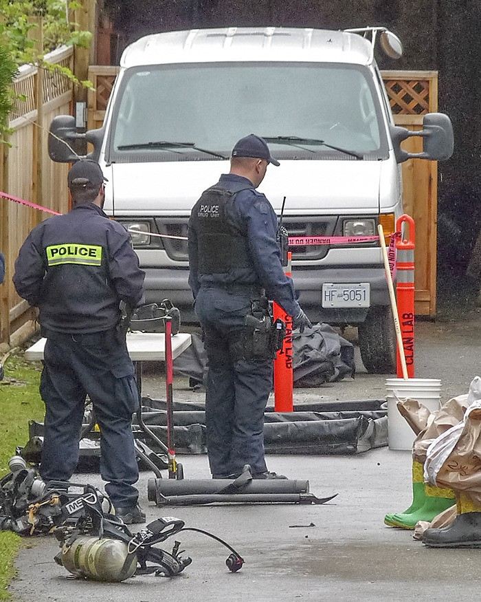 Police investigate a suspected drug lab on 72 Avenue near 208 Street in Langley Thursday. The investigation led to the search of a storage unit at Sunnyside Storage (below) in South Surrey Friday morning.