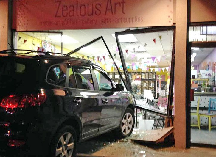A vehicle crashed through the glass windows of Langley City's Zealous Art studio on Wednesday evening.