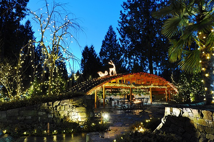 A covered seating area featuring a stone bench and a living roof is one of the elements that create Evelyn Faulkner's (below) magical Japanese-style garden at 21004 43 Ave. It is open to visitors from 6 p.m. to 10 p.m. each Friday and Saturday in December.