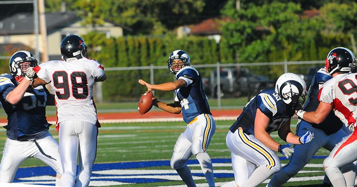 Langley Rams quarterback Jordan McCarty gets ready to fire a pass during his team's home finale at McLeod Athletic Park on Sept. 27. McCarty threw three touchdown passes in the Rams' regular season finale, a 48-17 win over the Valley Huskers.