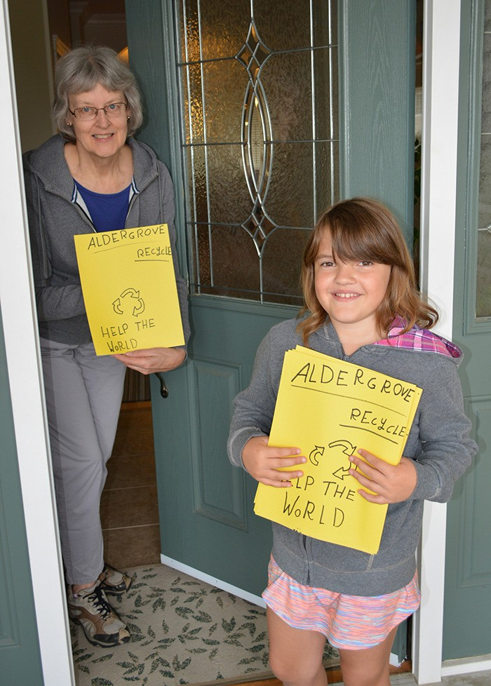 Eileen Van Pelt, left, and her granddaughter Ashley, show off posters Ashley made as part of a class project promoting environmental awareness and responsibility.
