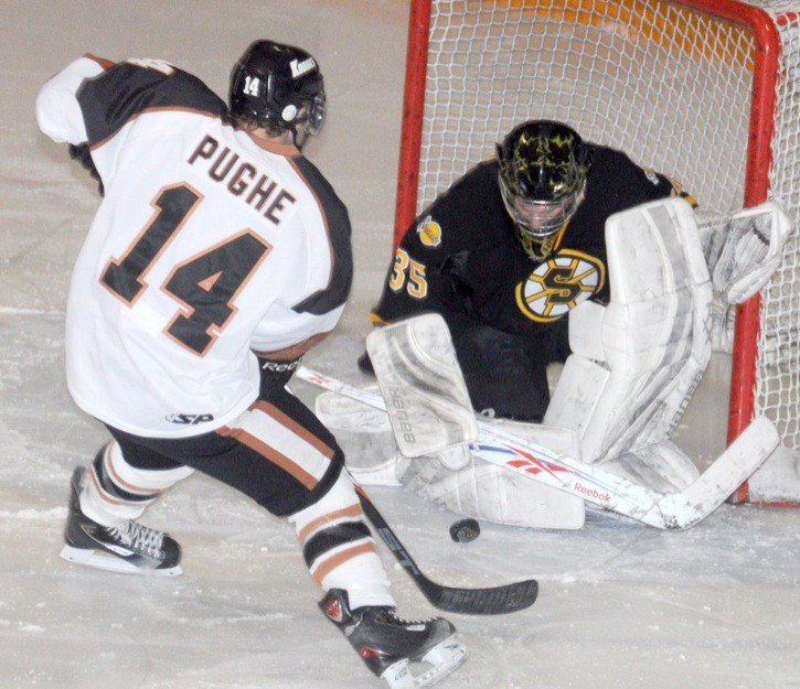 Aldergrove Kodiaks' Jordan Pughe is denied by Grandview Steelers goalie Tyler Read during PIJHL action earlier this season.