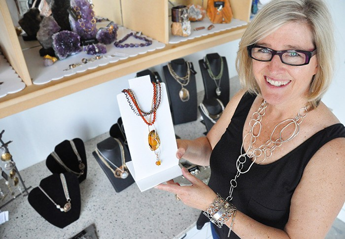 One of Karyn Chopik's new necklaces features a large Amber stone. Because of it's growing popularity in Asia, the world supply of amber is depleting and is becoming more difficult to order, Chopik said.