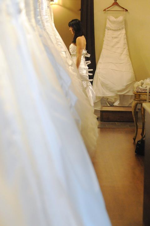 A new bride tries on a gown at Ivory Bridal during their trunk show for Alyne Bridal recently. The small shop has been in Walnut Grove for four years and was named Small Business of the Year in 2012 by the Langley Chamber of Commerce.