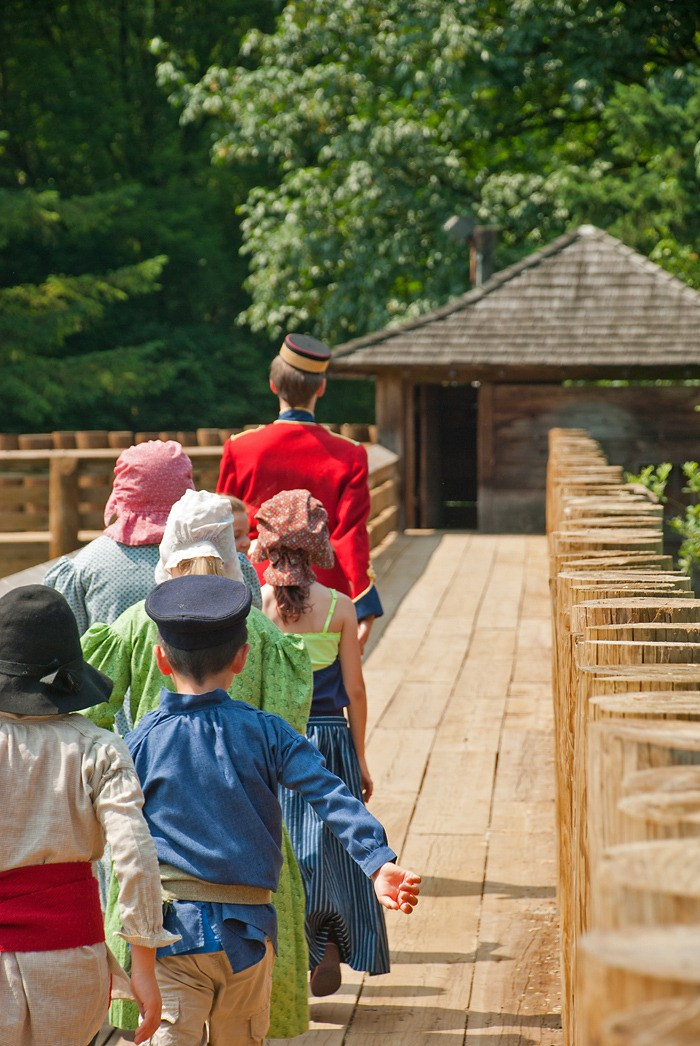 Pte. Charles Manley leads his young troops along the palisade at Fort Langley National Historic Site. Several times each week until Aug. 7, visitors can take part in interpretive programs related to the War of 1812.