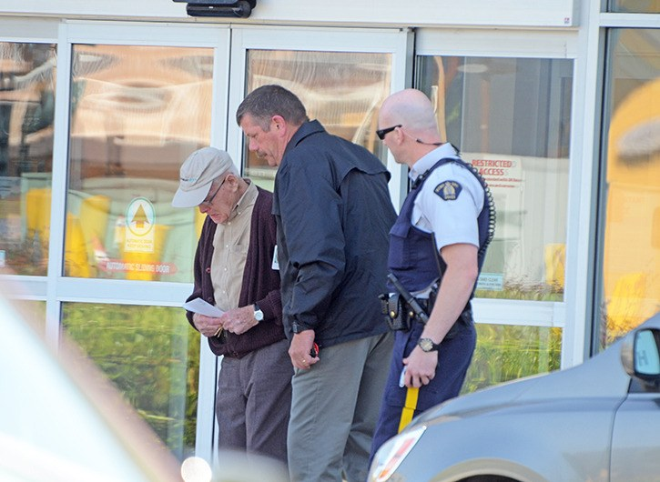 Chilliwack RCMP officers with William Mooney on Thursday morning outside the Envision Credit Union where he was last seen May 1.