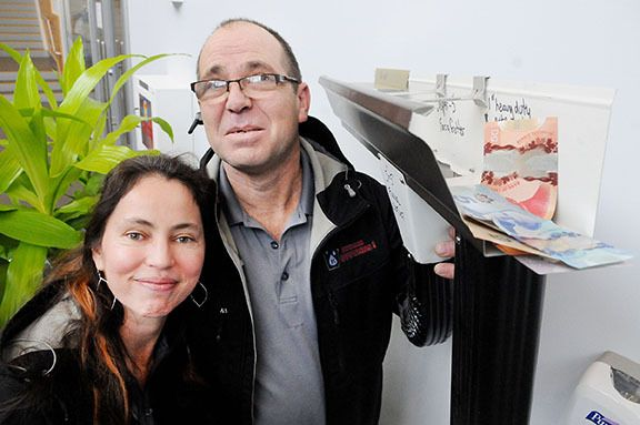 Kymar Gutters Inc. co-owners Marcela Ferreira and Kyle Chester are donating dollars to various Langley charities and are challenging other businesses to do the same.