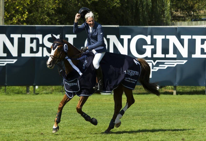Richard Fellers riding Flexible salutes the crowd after winning the Longines FEI World Cup Jumping event at Thunderbird Show Park on Sunday (Aug. 16).
