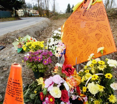 A memorial to flagger Terry Mitchell, who was run down and killed by Melle Pool on Feb. 25, 2008, sprung up along River Road shortly afterwards. Pool's sentencing hearing is now underway.