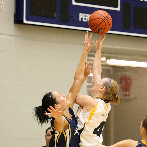 The Trinity Western Spartans opened the preseason with a 62-56 victory over the UBC Okanagan Heat.