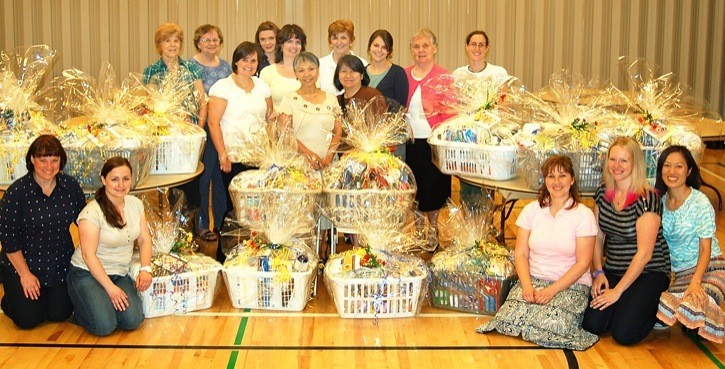 Women of the Church of Latter Day Saints' Relief Society assembled and wrapped 12 laundry baskets for Ishtar Transition House, on June 11. The baskets contain more than $100 worth of cleaning and household supplies given to Ishtar women.
