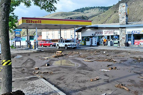 The aftermath of a flash flood in Cache Creek shows the mud and debris that was left behind.