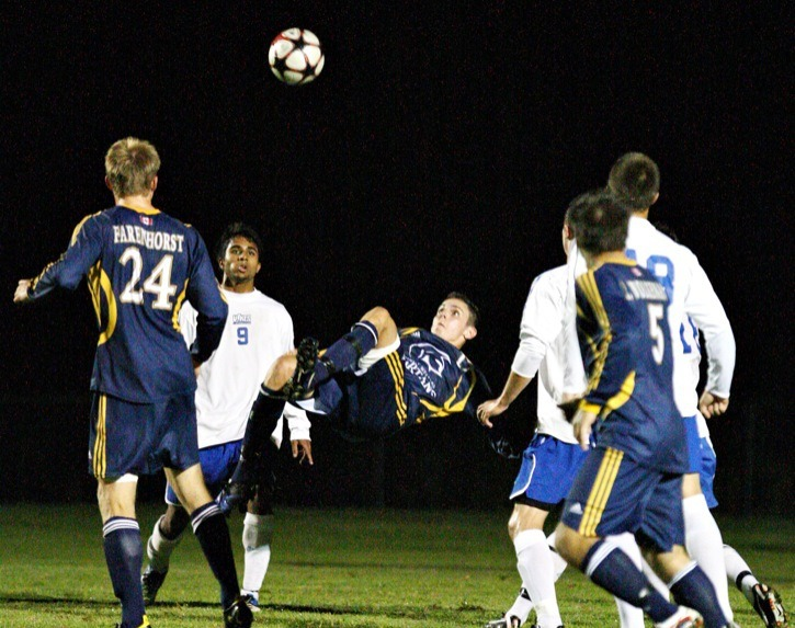 Trinity Western Spartans Brayden Gant executes a bicycle kick in his team's match against the Victoria Vikes on Saturday night at Rogers Field. The Spartans won 2-1 after losing their season opener 1-0 the previous night to the Fraser Valley Cascades.