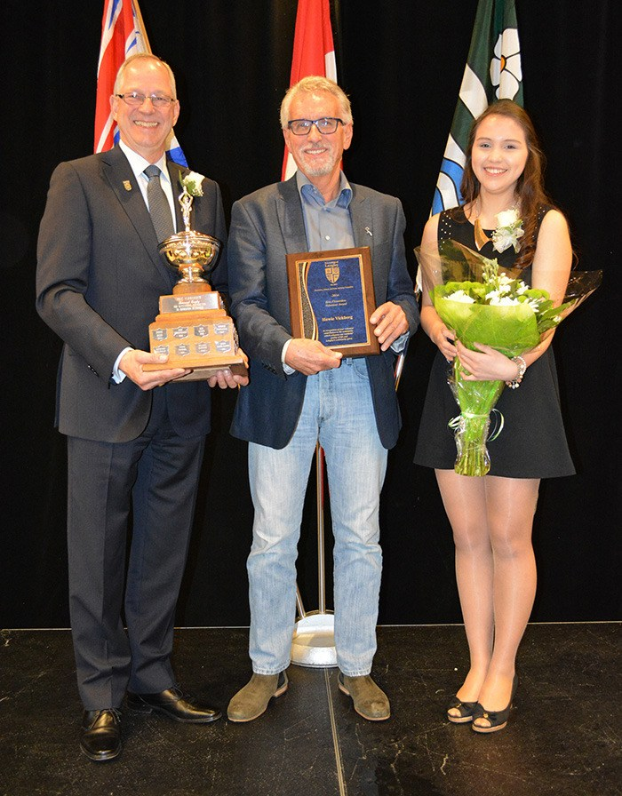 Township of Langley mayor Jack Froese (left) and Cassidy Hryckiw, a member of the Township of Langley's Youth Advisory Committee (right) present Howie Vickberg with the Eric Flowerdew Volunteer of the Year award. A banquet honouring Langley's volunteer community was held at the Langley Events Centre on April 2; below: Ted and Lynda Lightfoot received the John and Muriel Arnason Award.