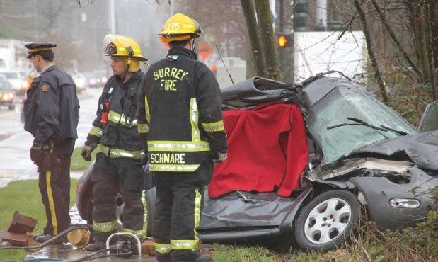 Emergency crews attend a fatal accident Friday.