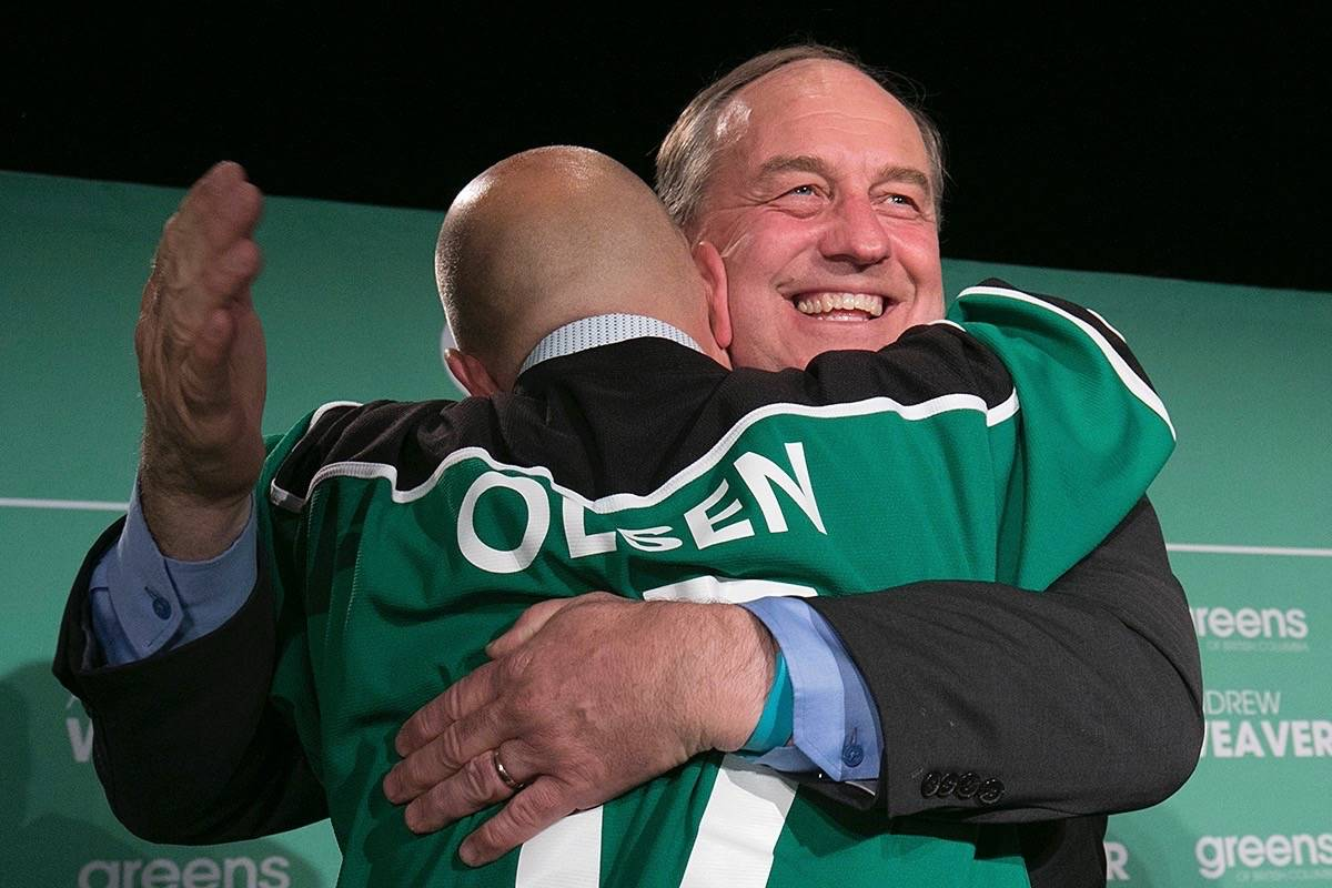 B.C. Green Party leader Andrew Weaver celebrates his party breakthrough with new Green MLA Adam Olsen. (Arnold Lim/Black Press)