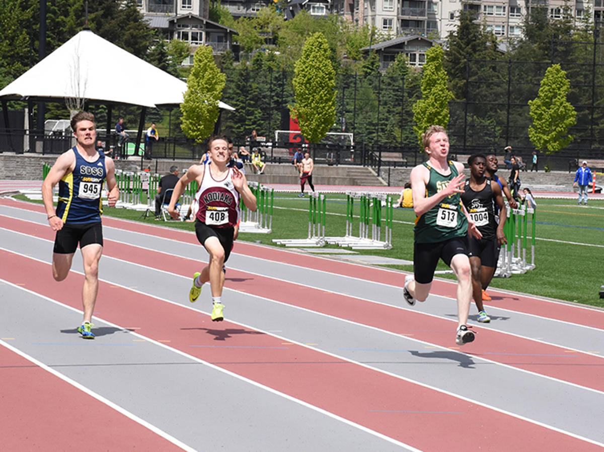 Langley Saints' Kevin Hughes wins the senior boys 200m race last week at the Fraser Valley track and field championships in Coquitlam. Owen Munro Black Press