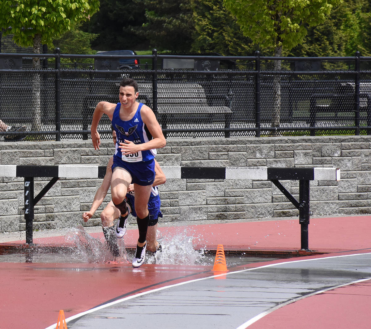 Zach Wyatt leads his twin brother Tate in the senior boys 2000m steeplechase at the Fraser Valley track and field championships in Coquitlam. The brothers finished one-two in the event. Owen Munro Black Press