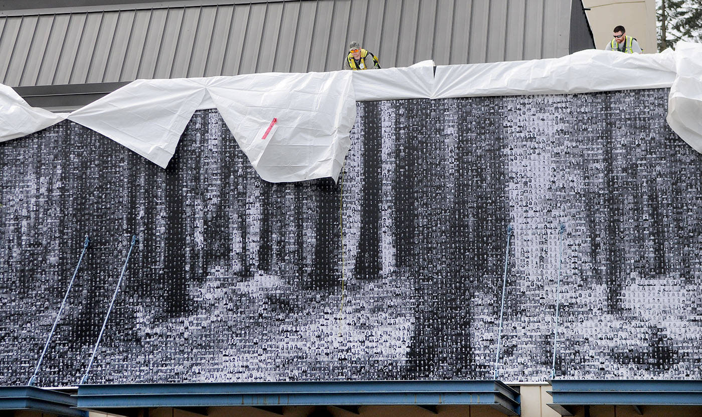 During a ceremony on May 19, tarps were pulled back outside of Langley Fine Arts School's Chief Sepass Theatre, to unveil more than 6,000 photographs of all of the students and staff in Langley Fine Arts School. The photos were arranged to form an image of the Blauuw Forest. Troy Landreville Langley Times