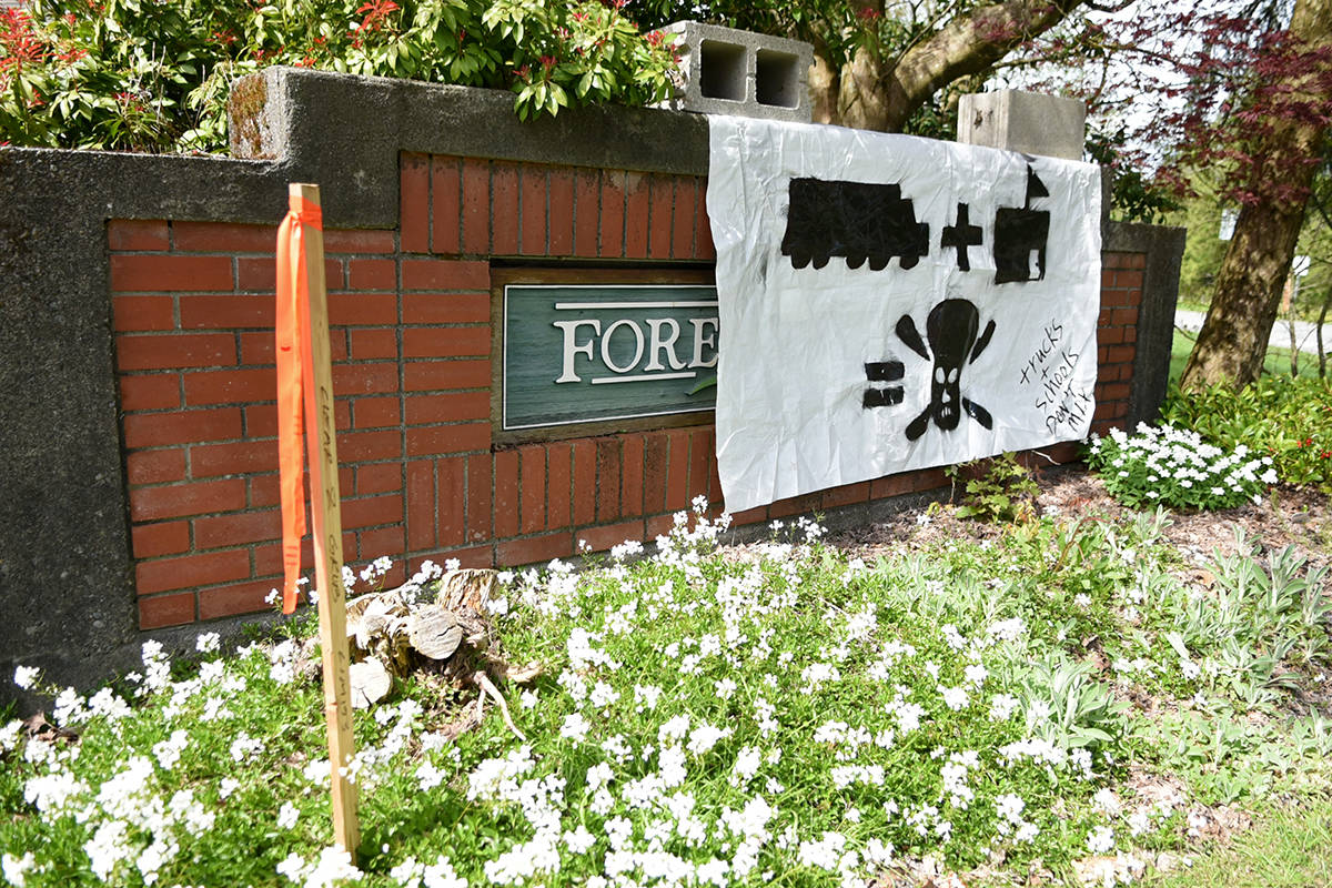 """A banner hanging on the Forest Hills subdivision sign reads """"trucks and schools don't mix."""" Miranda Gathercole Langley Times"""