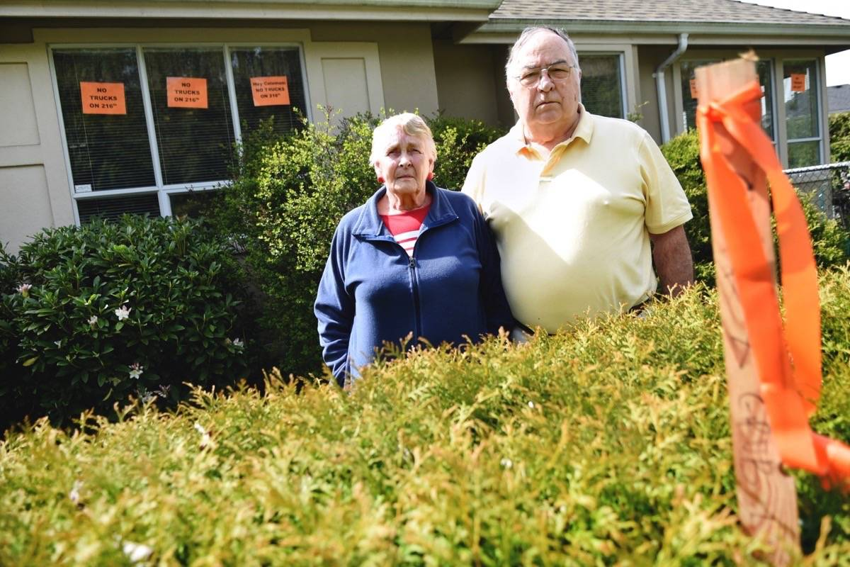 A stake dug in the centre of Betty and Gene Nelson's hedge shows where a new 10-foot sound wall will be built with the 216 Street Interchange Project. The senior couple, who live on the corner of 216 Street and Telegraph Trail, believe their quality of life will be greatly impacted by this project. Miranda Gathercole Langley Times