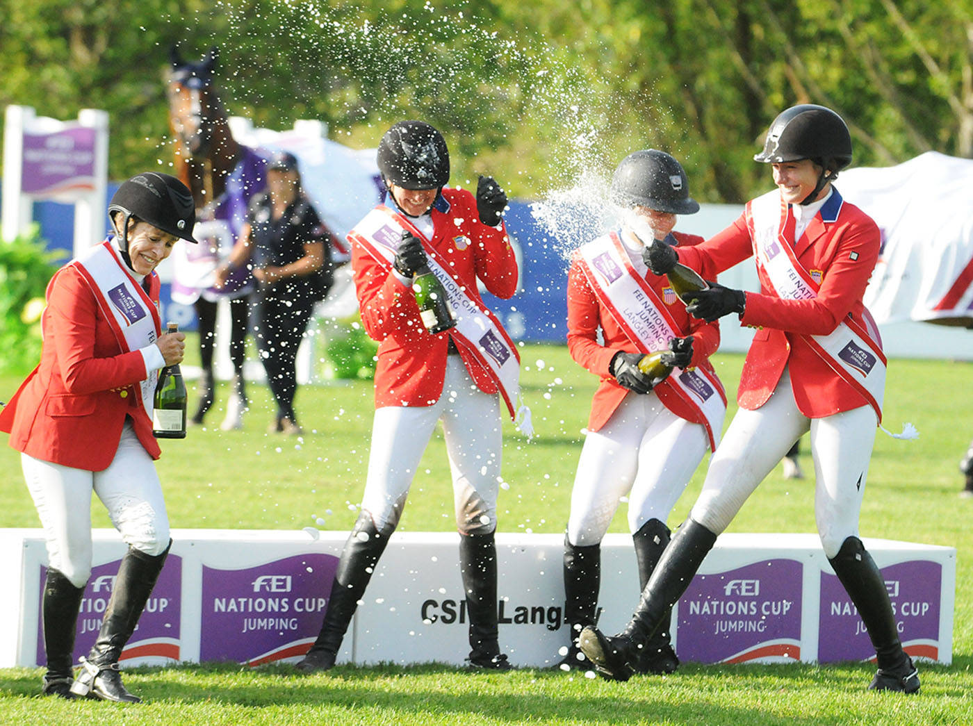 Team USA celebrated their FEI Nations Cup victory by spraying each other with champagne. Troy Landreville Langley Times