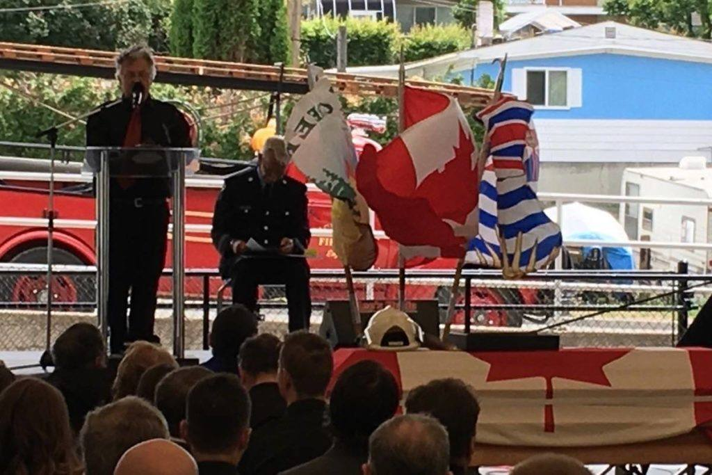 Clayton Cassidy's brother, Patrick, speaks at the service for the fire chief who died after he was swept away by heavy floods in early May. The line of duty memorial was held Saturday at Cache Creek Park. Credit: Kevin MacDonald