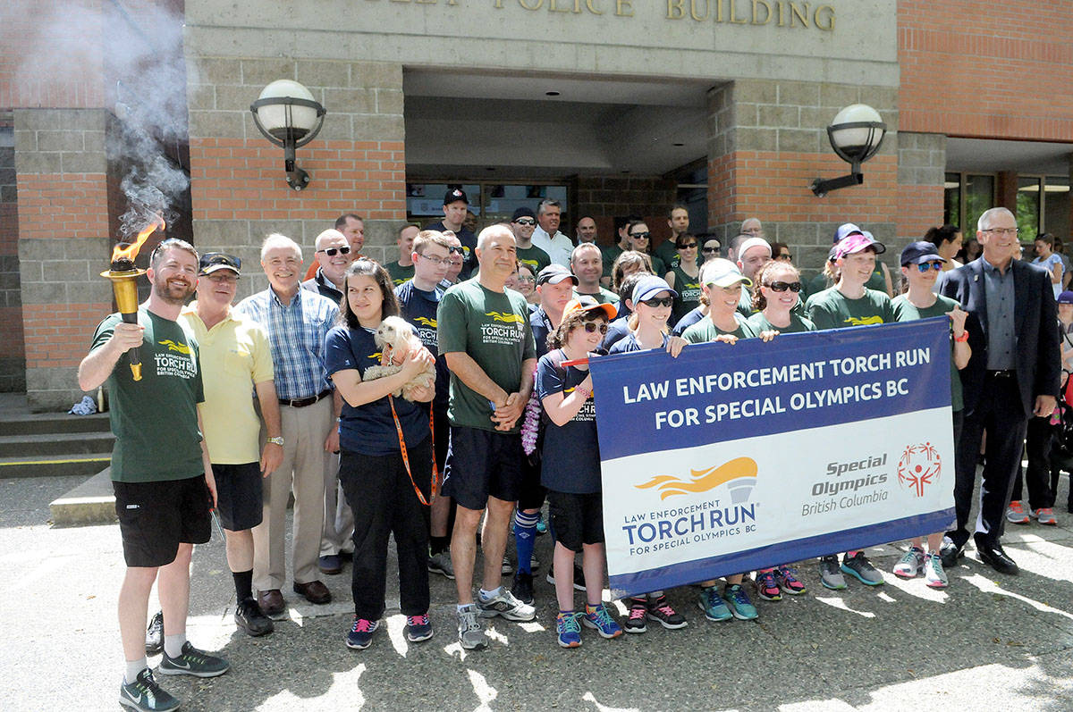 Participants gathered for a group photo in front of the Langley RCMP detachment in Murrayville on Tuesday afternoon, June 6, before embarking on the Langley leg of the 2017 BC Law Enforcement Torch Run in support of Special Olympics BC.                                Troy Landreville Langley Times
