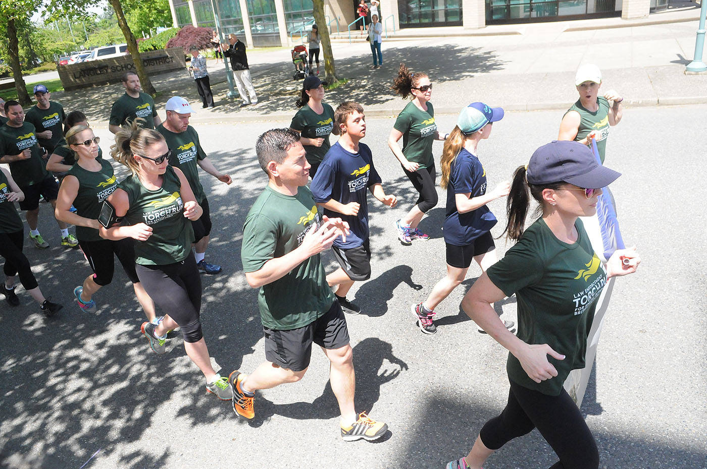 Law enforcement personnel and Special Olympics BC athletes left the Langley RCMP detachment in Murrayville Tuesday afternoon, June 6, to kick off the local leg of the 2017 BC Law Enforcement Torch Run. Troy Landreville Langley Times