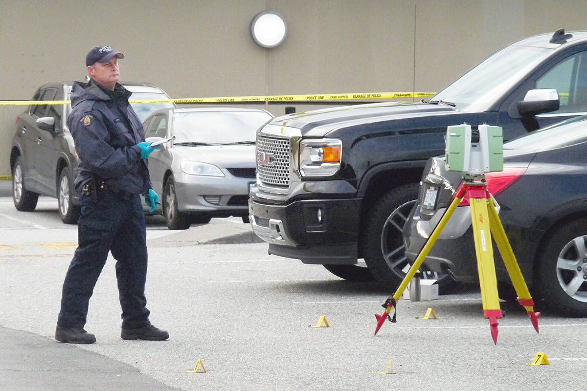 An investigator takes measurements at the scene of a fatal shooting in Langley. Dan Ferguson Langley Times