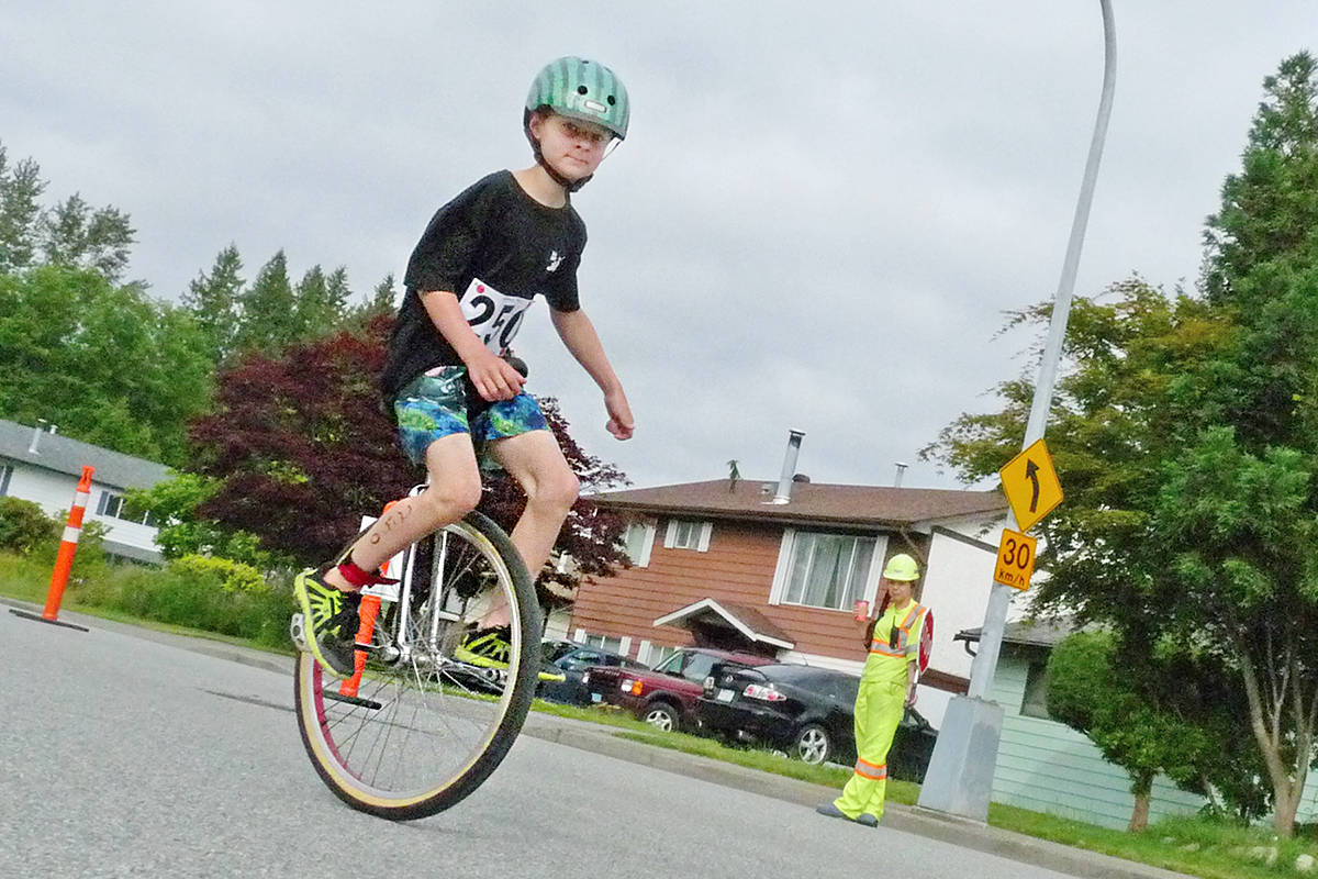 Yes, that's a unicycle. Matthias Fox added an additional degree of difficulty to his bike race. Dan Ferguson Langley Times
