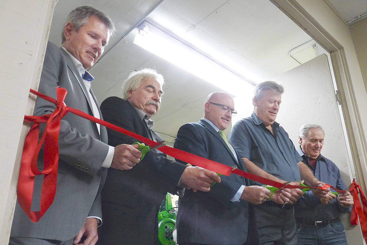 Cutting the ribbon to officially open the new shop area at the Farm Museum. From left: MP John Aldag, museum association president Todd Davidson, acting Langley Township mayor Blair Whitmarsh, MP Rich Coleman and museum volunteer Laurie Griffiths.