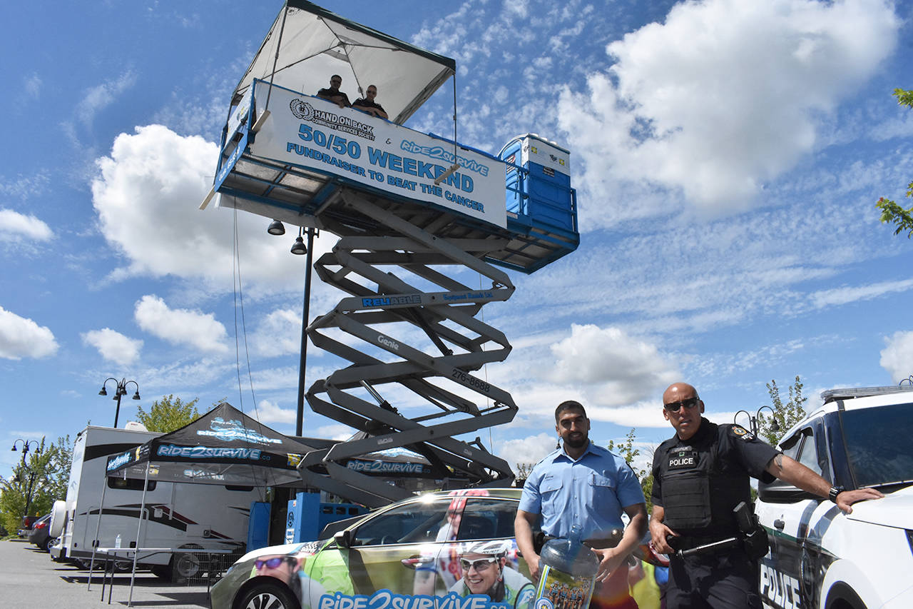 DPD reserve Const. Abu Ghafoori (left) and Const. Ken Usipiuk (right) pose in front of Sgt. Ray Warren and Const. Sukhi Thind, who will be spending 50 hours in the air in support of Ride2Survive and Cops for Cancer. (Grace Kennedy photo)