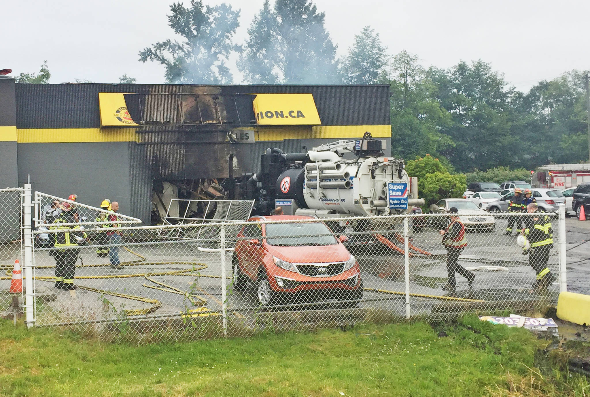 A stolen Super Save truck was driven through the front wall of a Langley City auto dealership overnight Wednesday, causing both the truck and the building to burst into flames. City fire crews were called out around 2:45 a.m. and required help from Township fire department to extinguish the fire, which did extensive damage to the building. Brenda Anderson Langley Times