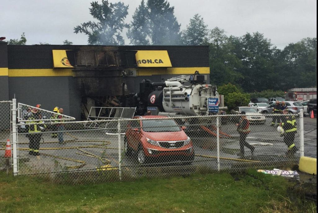 VIDEO: Stolen truck driven into front of Langley City auto dealer sets building on fire