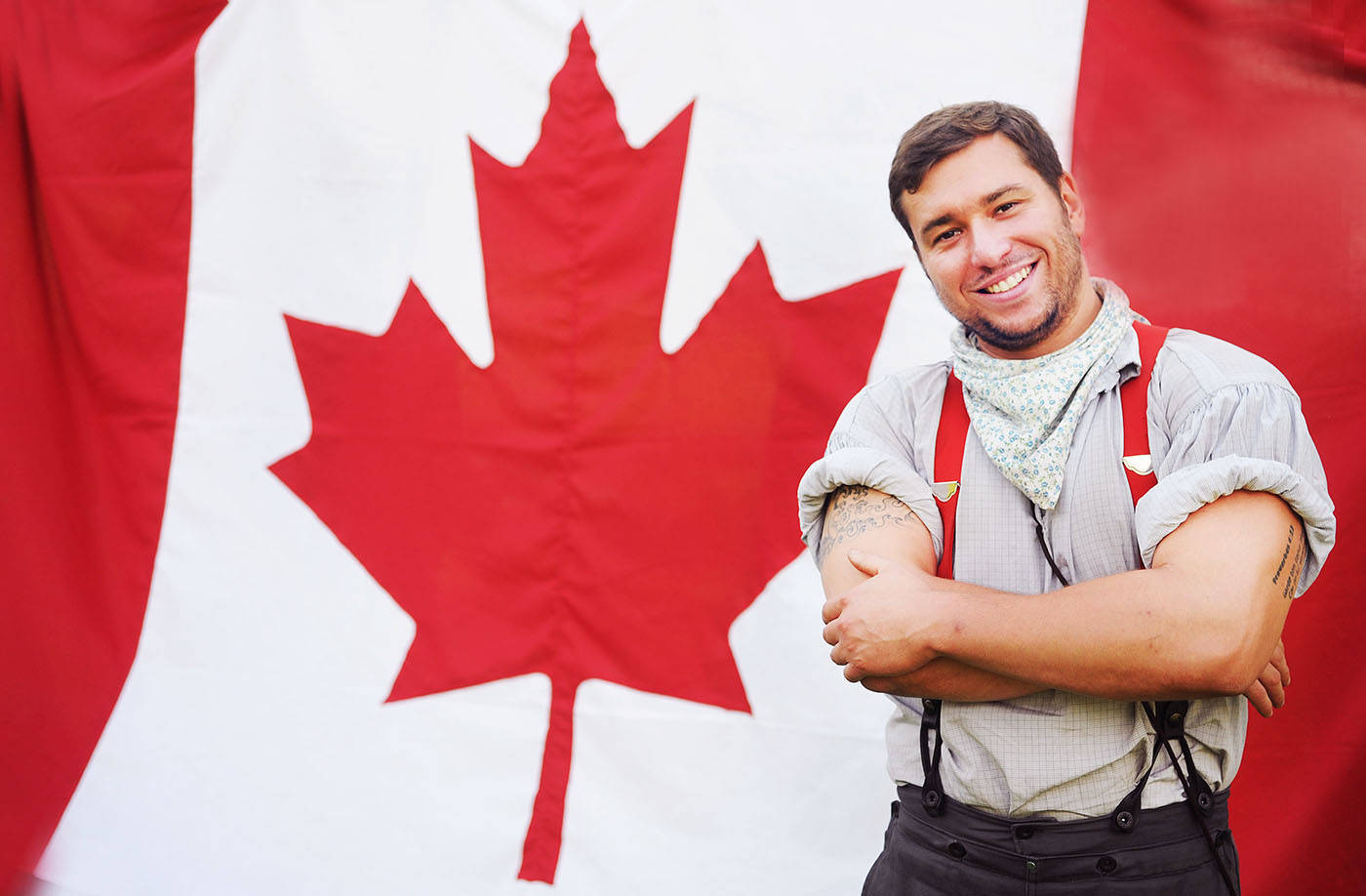 Interpreter Jonathan Fortier stands in front of a giant Canadian flag at the Fort Langley National Historic Site, which is celebrating Canada Day this Saturday, July 1 with re-enactments, cake, a citizenship ceremonies, and many other activities. The Fort's Canada Day celebration is free to attend. There will also be free family celebrations at Willoughby Community Park (next to the Langley Events Centre), as well as in Aldergrove. For a full listing of local Canada Day events, look in the Wednesday, June 28 edition of the Langley Times or online at www.langleytimes.com.                                Troy Landreville Langley Times