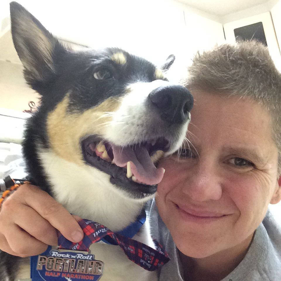 Alice Fox/Facebook                                RCMP member Alice Fox with her dog Jasper, holding a medal from the Rock 'n' Roll Portalnd half marathon. To deal with her PTSD, Cloverdale resident Alice Fox ran a marathon a week in 2015. The medals are hanging up on her apartment wall.