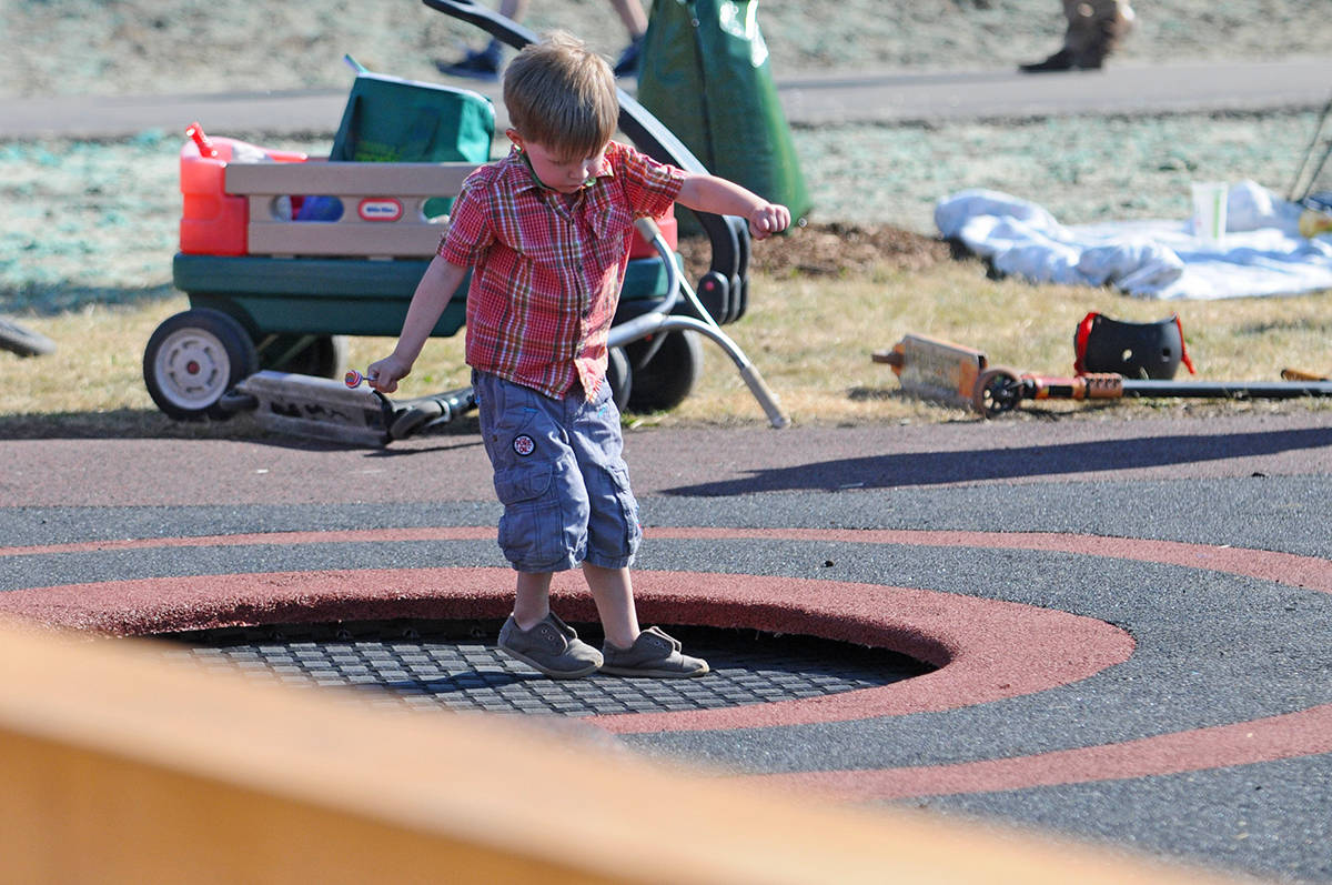 A young boy tries on a ground level trampoline during the grand opening of Penzer Park's new outdoor parkour facility. Miranda Gathercole Langley Times