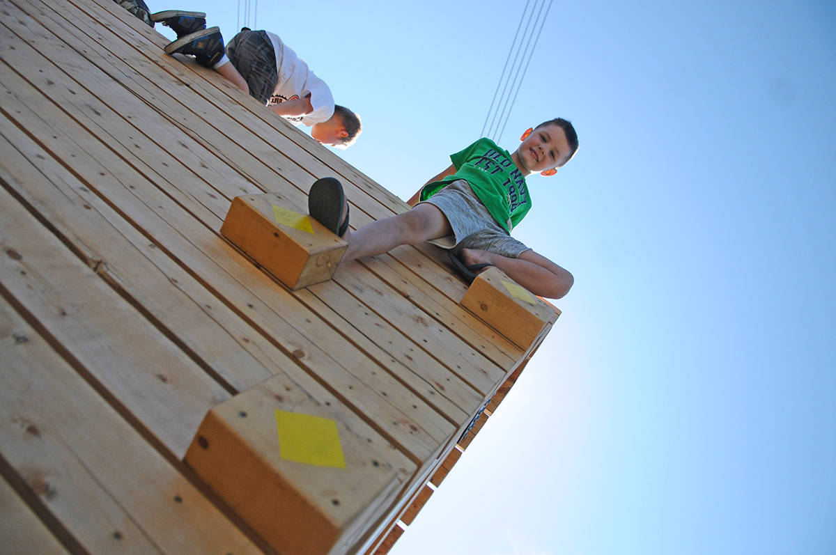 Langley City resident Brennan Neufeld, 5, climbs up on a piece of equipment during the grand opening of Penzer Park's new outdoor parkour facility. Miranda Gathercole Langley Times