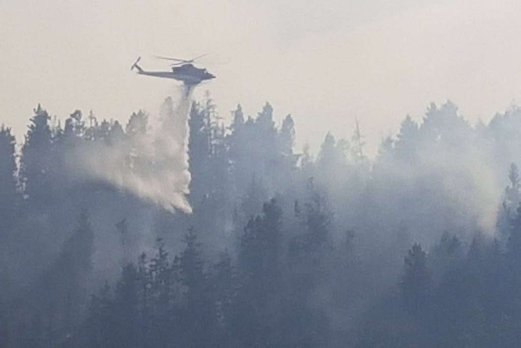 A helicopter sprays the wildfire in Princeton.                                A helicopter sprays the wildfire in Princeton. (Black Press)