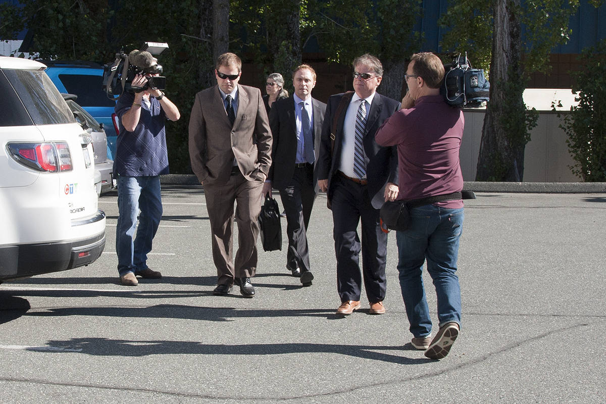 Swarmed by media, Kenneth Jacob Fenton (left) and his lawyers Chris Massey and Dale Marshall enter Western Communities Court for sentencing Friday. (Katherine Engqvist/News Gazette staff)