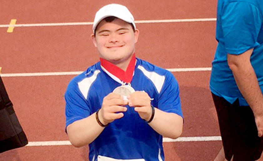 Langley athlete Marcus Fauchon won silver in long jump and bronze in the 200m sprint at the Special Olympics BC Summer Games, held in Kamloops July 6 to 8. Submitted photo