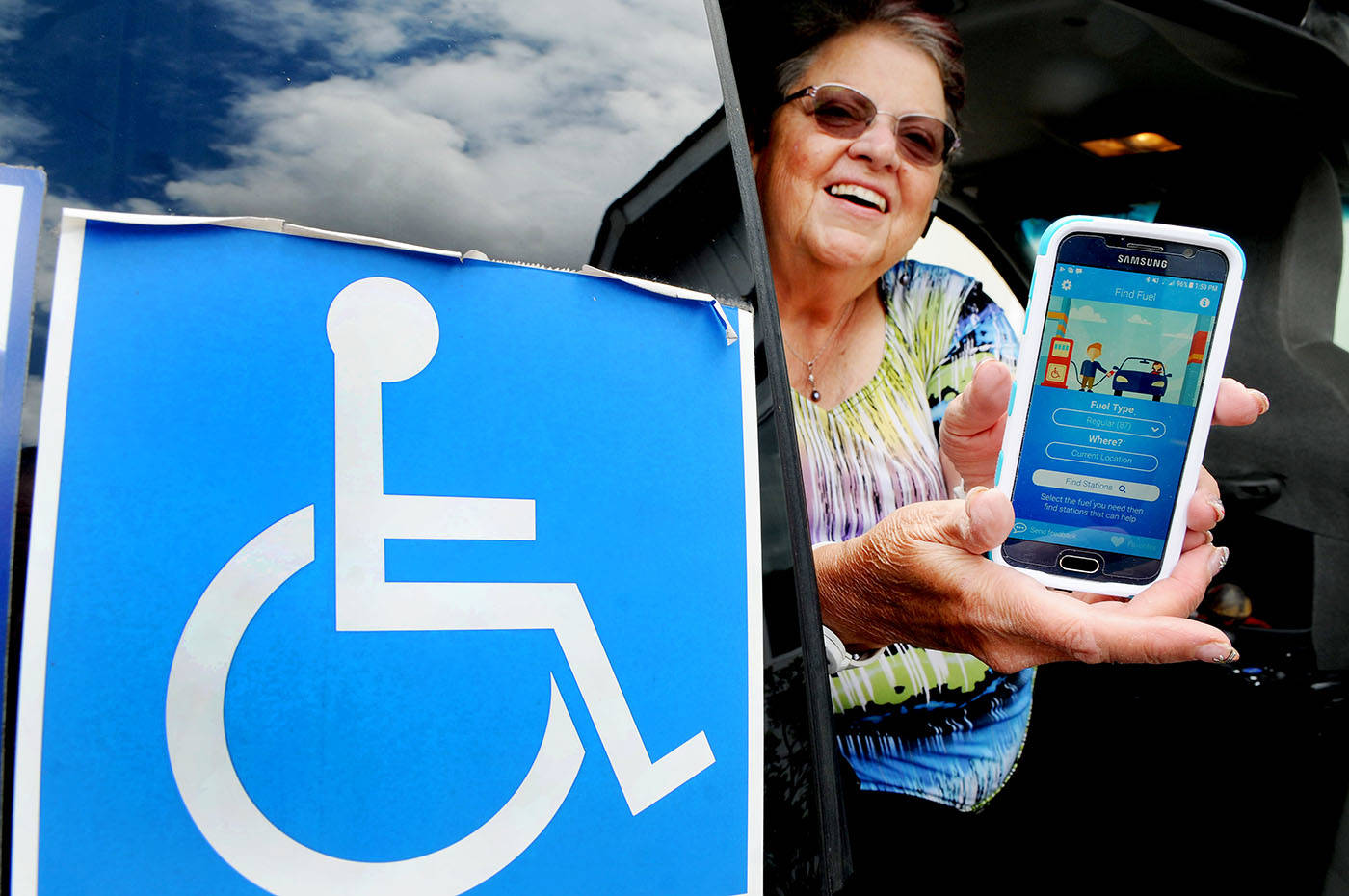Langley Pos-Abilities Society founder Zosia Ettenberg showed an app, released exlusively in Langley, that helps disabled drivers get fuel in their cars. Troy Landreville Langley Times