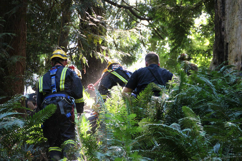 Surrey fire department rescued a woman from Delta Creek she had been trapped there for five days. (Shane MacKichan photo)