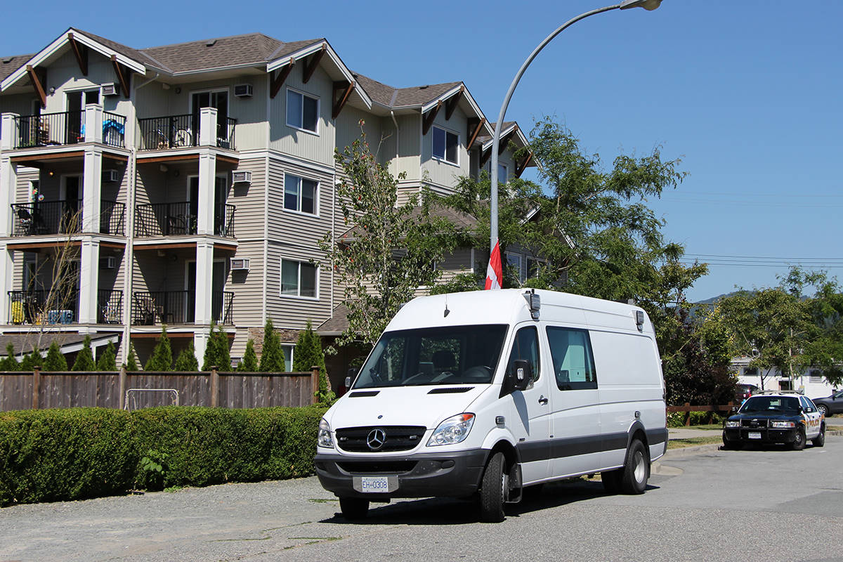 A forensics identification unit and an Abbotsford Police patrol car were at an apartment complex on Braun Avenue on Tuesday afternoon, where officers are investigating a suspicious death. (Vikki Hopes/Abbotsford News)