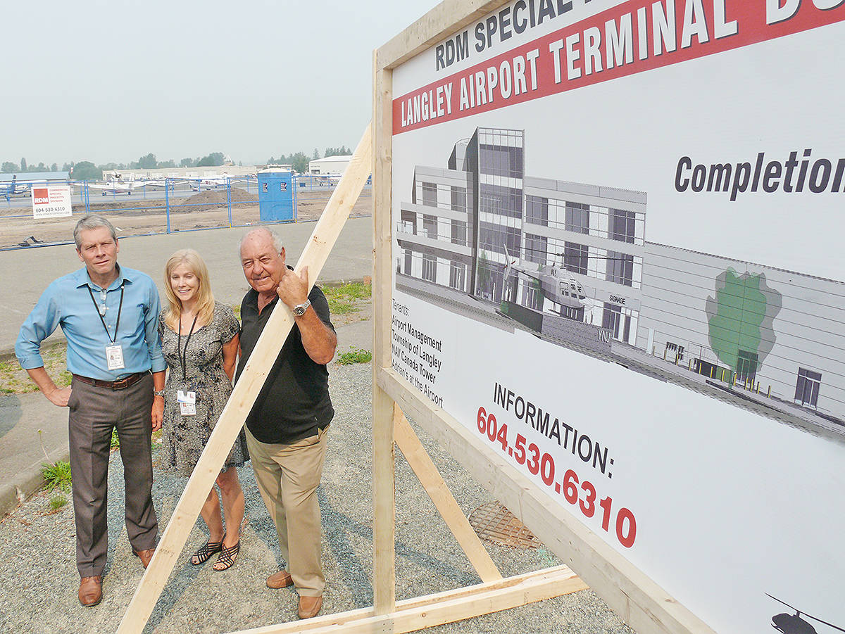 Construction is underway on a new $10 million terminal building at the Langley Regional Airport that will also house the NAV Canada control tower, Township offices and Adrian's At The Airport Restaurant. The sign announcing the project went up Tuesday morning. L to R: airport manager Guy Miller, operations manager Carol Madill and RDM Enterprises Group president Ron Madsen, builder of the project. Dan Ferguson Langley Times