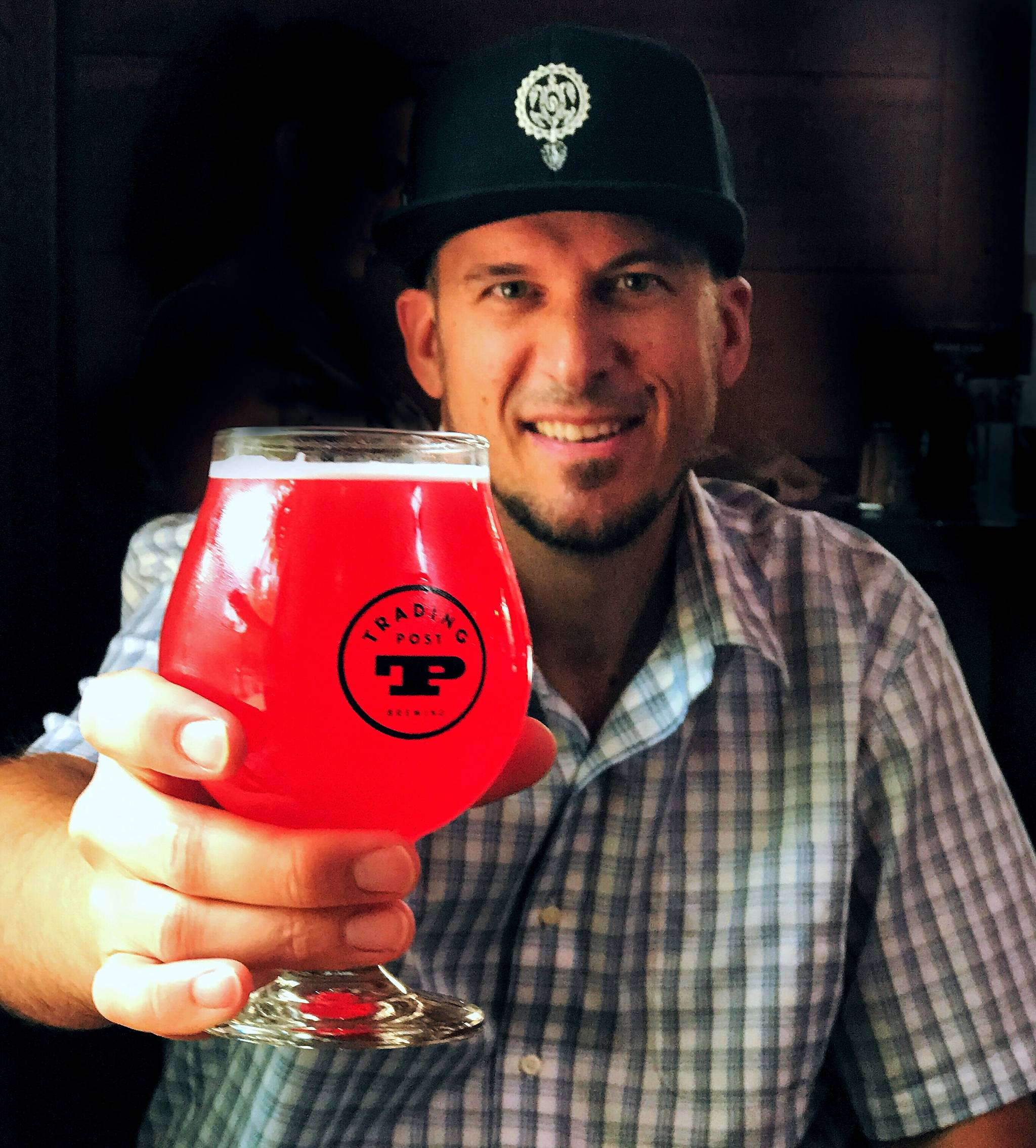 Langley resident and B.C. craft beer enthusiast is hosting a contest that has helped raise more than $7,000 to help fire victims. This picture was taken at the Trading Post Taphouse and Eatery in Fort Langley where he was drinking their newly released Captain Coopers Tart Cranberry Ale. Theresa LaHay photo